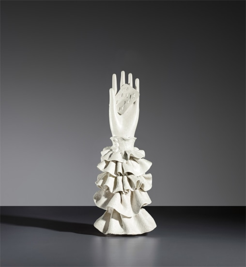 Hand with playing card statuette