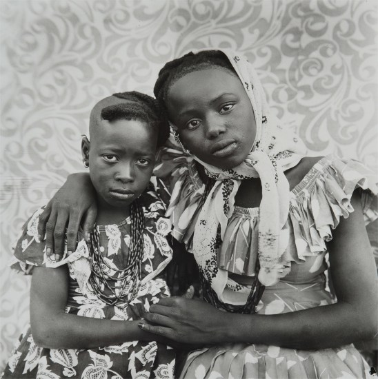 Untitled (two sisters with their arms around each other)