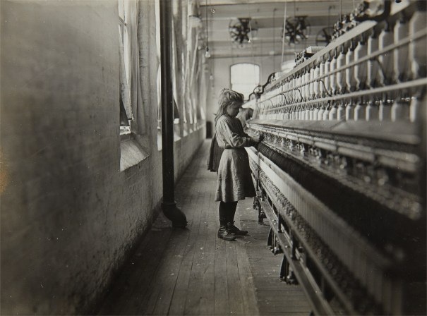 One of the little spinners working in a South Carolina Cotton Mill