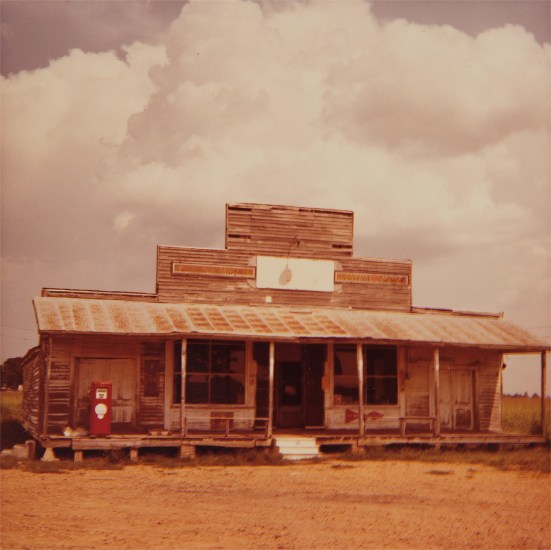 Untitled (rural gas station with pump)