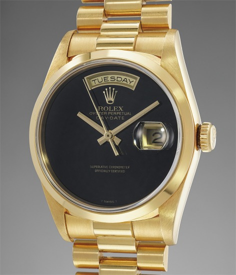 A fine, rare and very attractive yellow gold automatic wristwatch with day, date, onyx dial, bracelet and guarantee