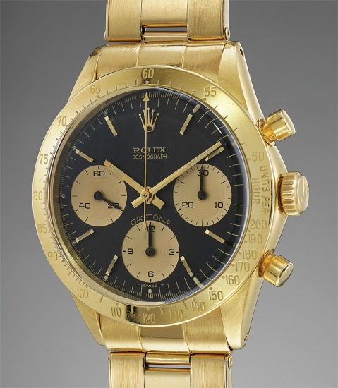 A fine, very rare and extremely attractive yellow gold chronograph wristwatch with black dial, bracelet and box