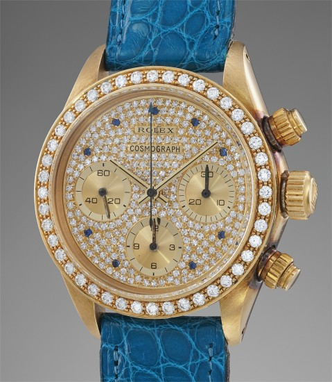 A stunning, possibly unique and extremely well preserved yellow gold and diamond-set chronograph wristwatch with pavé dial