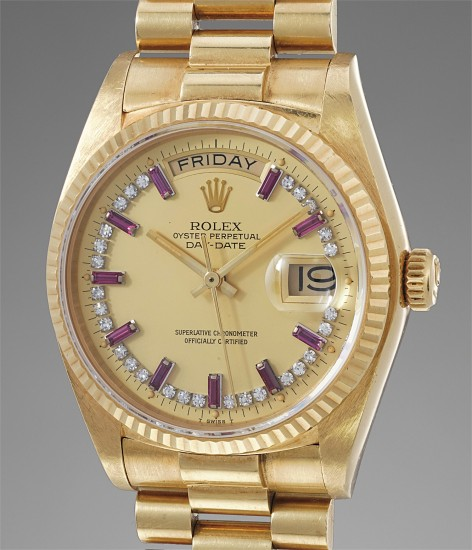 A rare and attractive yellow gold, diamond and ruby-set calendar wristwatch with bracelet