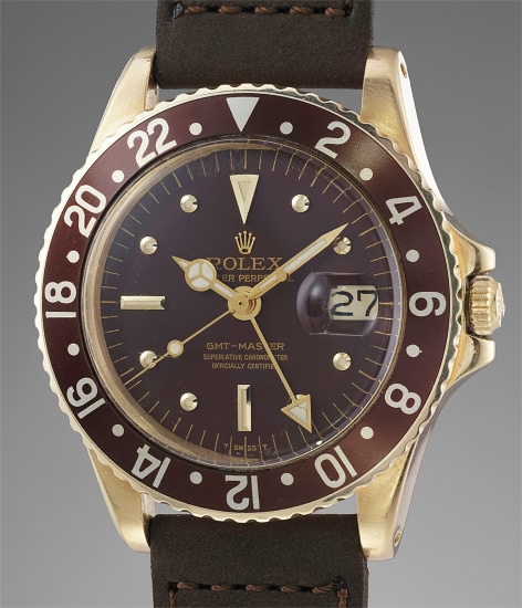 A fine and very rare yellow gold automatic dual time wristwatch with center seconds and date