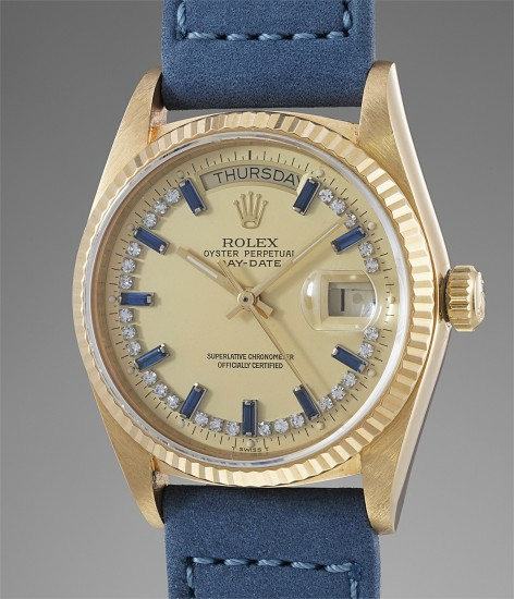 A rare and attractive yellow gold, diamond and sapphire-set calendar wristwatch with center seconds
