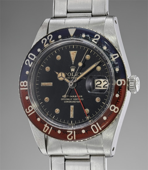 A very attractive and well preserved stainless steel dual time wristwatch with Bakelite bezel, bracelet and box
