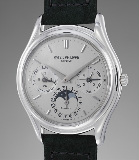 The only known and attractive platinum perpetual calendar wristwatch with original certificate, retailed by Tiffany & Co.