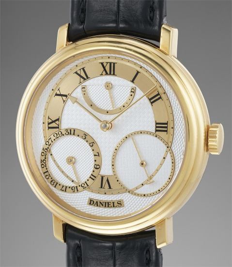 An extremely rare, historically important and attractive yellow gold wristwatch with power reserve indicator and date