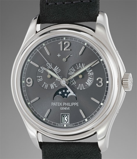 A fine, rare and elegant white gold annual calendar wristwatch with center seconds, moonphases, power reserve indication, certificate and box