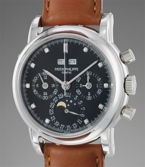 A rare and attractive platinum and diamond-set perpetual calendar chronograph wristwatch with moonphases and additional caseback