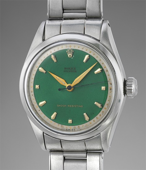 An attractive stainless steel wristwatch with green enamel dial and bracelet