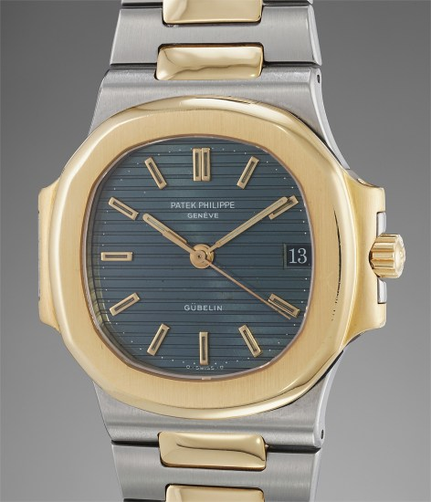 A very attractive stainless steel and yellow gold wristwatch with date, sweep center seconds and bracelet, retailed by Gübelin