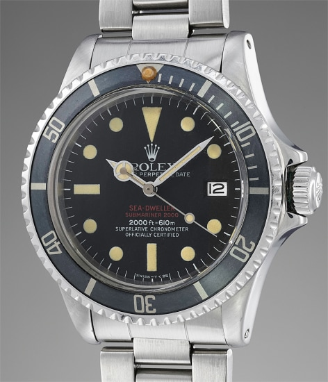 A rare and attractive stainless steel wristwatch with center seconds, date, guarantee and presentation box