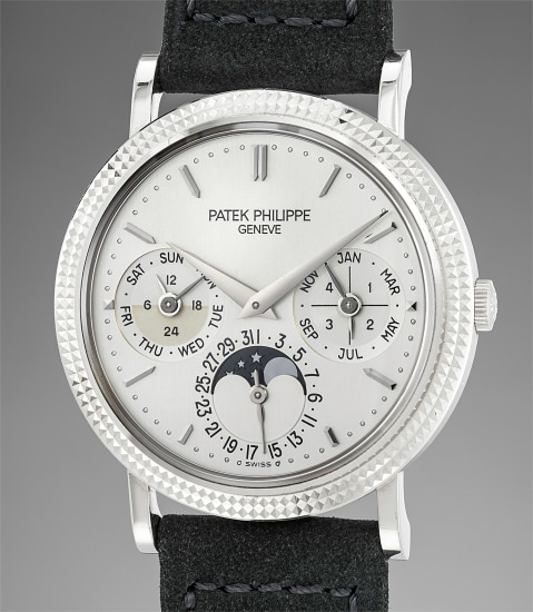 A fine and attractive white gold perpetual calendar wristwatch with moonphases, 24 hour indication, additional sapphire caseback, winding box and original certificate