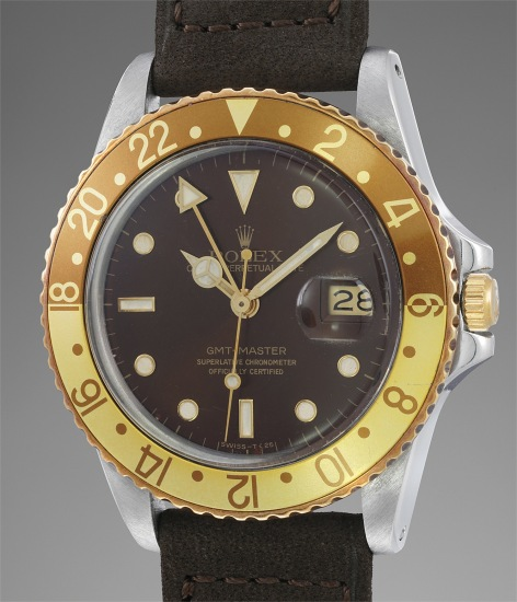 An exceedingly well-preserved and attractive stainless steel and yellow gold dual-time wristwatch