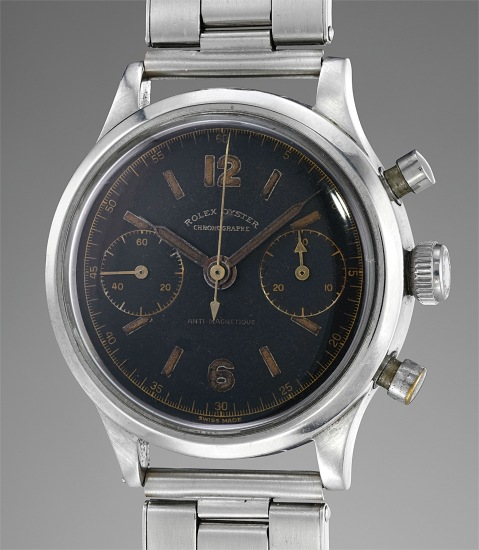 A rare and attractive stainless steel chronograph wristwatch with black lacquer dial and bracelet