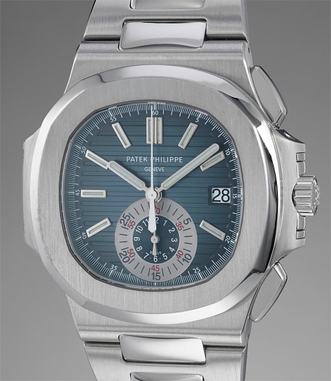A rare and attractive stainless steel chronograph wristwatch with date, bracelet, original certificate, sales tag, setting pin, fitted presentation box and outer packaging