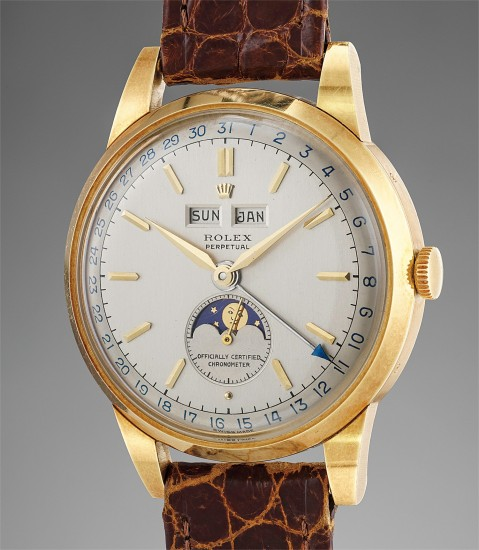 A large, attractive and exceptionally well-preserved triple calendar wristwatch with moonphases and two-tone dial, original box and numbered hang tag