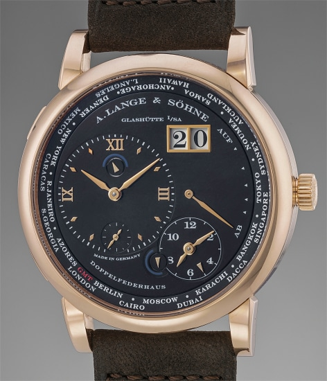 A very fine limited edition pink gold dual time wristwatch with date, power reserve indication, guarantee and box