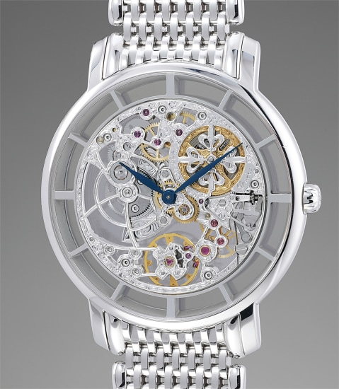 A rare and attractive white gold skeletonized wristwatch with bracelet, original certificate and presentation box