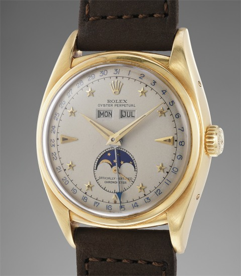 An exceptionally fine, rare and important yellow gold triple calendar wristwatch with star-set numerals and moonphases