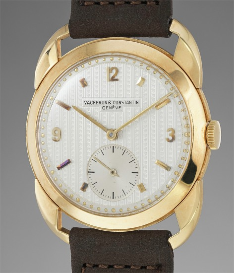 A fine, rare and unusual yellow gold wristwatch with guilloché dial and crab lugs