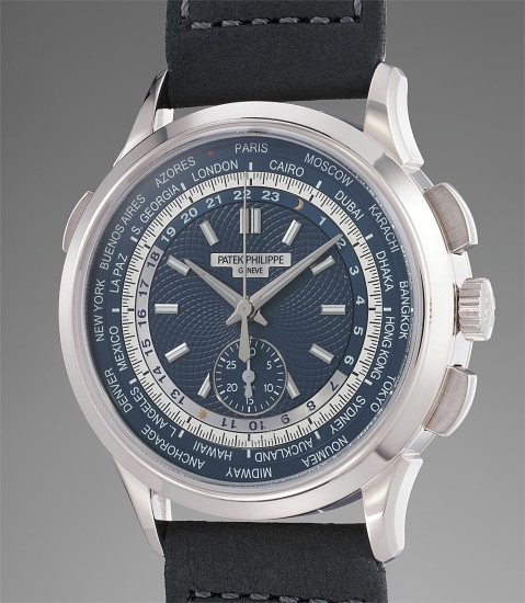 A fine, rare and unusual white gold world time chronograph wristwatch with certificate, invoice and box