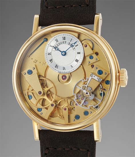 A fine and attractive semi skeletonized yellow gold wristwatch with power reserve