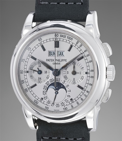 A fine and rare white gold perpetual calendar chronograph wristwatch with moonphases, certificate of origin, additional caseback and fitted presentation box