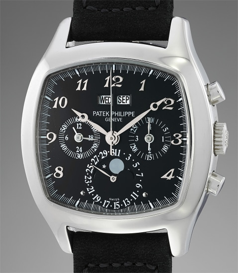 An impressive and most probably unique cushion shaped platinum perpetual calendar chronograph wristwatch with moonphases, black dial and Breguet numerals