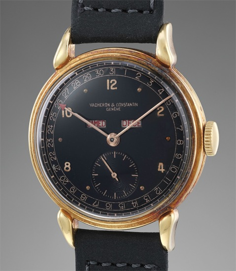 A fine and very rare yellow gold triple calendar wristwatch with and black lacquer dial