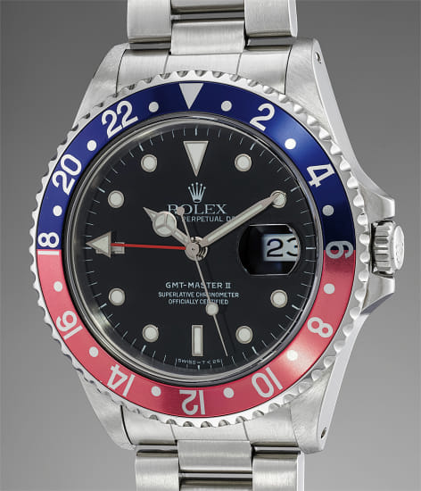 A very attractive stainless steel dual time wristwatch with bracelet, box and guarantee