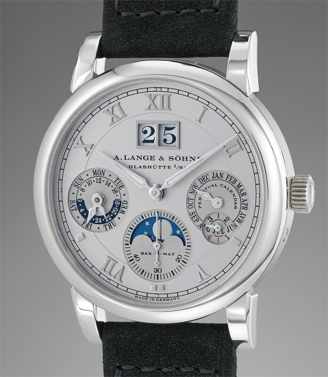 A very fine and elegant platinum perpetual calendar wristwatch with large date, moonphases, 24 hours indication, guarantee and winding box