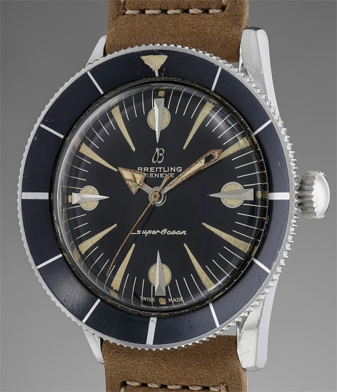 A very rare, attractive and extremely well preserved stainless steel diver's wristwatch with center seconds, black gloss luminous dial and revolving bezel