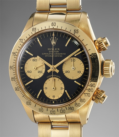 A very rare and attractive yellow gold chronograph wristwatch with black dial, champagne registers and yellow gold bracelet