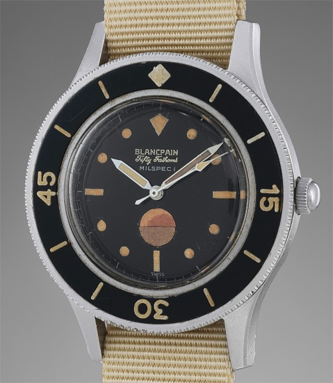 A rare and highly attractive stainless steel diver's watch with black glossy dial, humidity indicator and diving log book