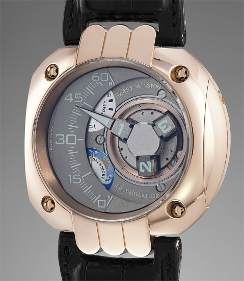 An impressive and rare limited edition pink gold wristwatch with three dimensional satellite hour display, retrograde minutes, five-day power reserve, day and night indication and five-year service indicator