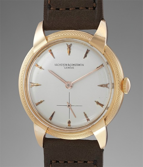 An extremely rare and attractive pink gold wristwatch with styled lugs and guilloché bezel