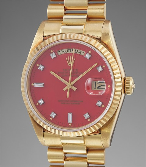 """A rare and extremely well-preserved yellow gold calendar wristwatch with red lacquer """"Stella"""" dial and bracelet"""