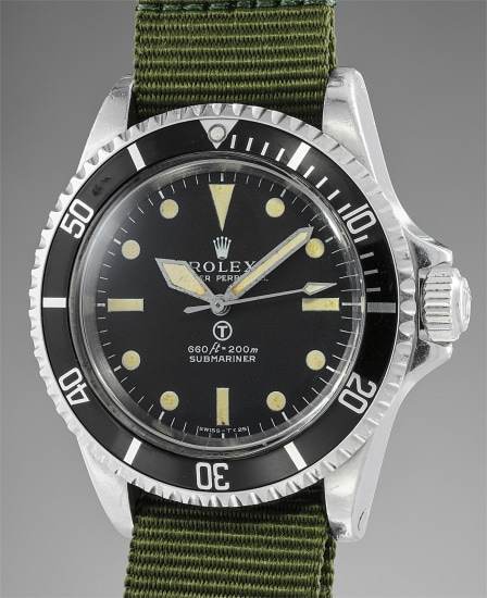 A very rare and highly attractive stainless steel military diver's wristwatch with rotating bezel, fixed bar lugs, and military engravings, made for the British Navy