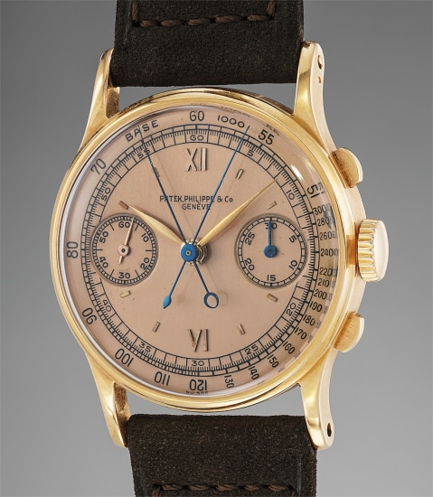 An extremely fine and rare pink gold split seconds chronograph wristwatch with pink dial