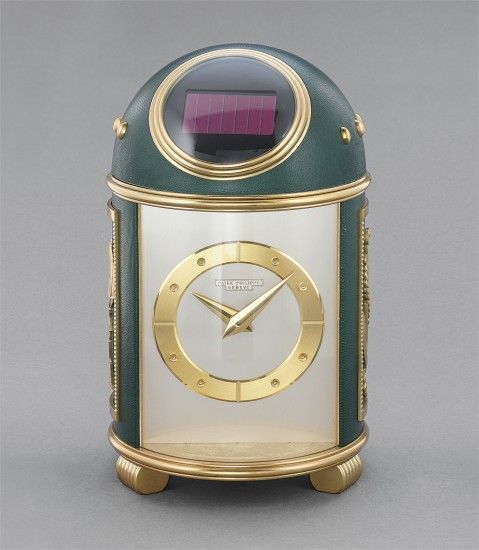A rare and attractive gilt brass and green leather dome clock with applied marine-style gilt ornaments and presentation inscription