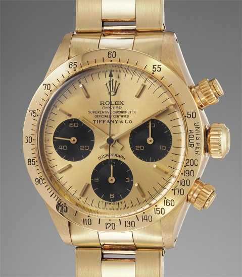 An impressive and attractive 14K yellow gold chronograph wristwatch with bracelet, retailed by Tiffany & Co.
