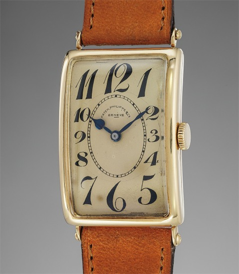 A fine, rare and elegant yellow gold rectangular wristwatch with champagne dial and Breguet numerals