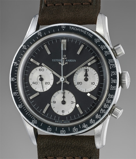 A very attractive, rare and large stainless steel chronograph wristwatch with tropical black dial and tachymeter bezel