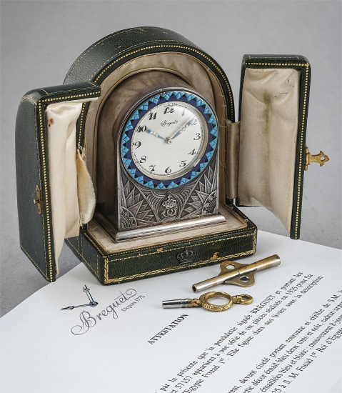 A historically interesting and well-preserved silver and enamel desk clock, delivered to King Fuad I of Egypt