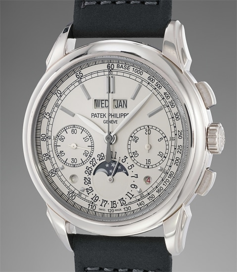 A fine and rare white gold perpetual calendar chronograph wristwatch with moonphases, leap year and day and night indicator, additional case back, original certificate and fitted presentation box