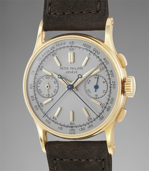 A rare and attractive yellow gold split seconds chronograph wristwatch with additional silvered dial