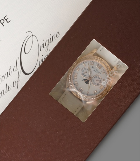 A very elegant pink gold lady's annual calendar wristwatch with diamond bezel, mother of pearl dial, moonphases, factory double sealed